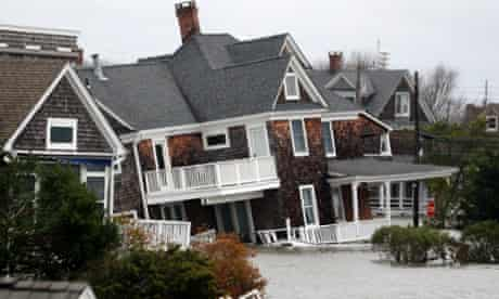 Floodwaters surround homes near the Mantoloking Bridge the morning after Sandy hit Mantoloking, New Jersey.