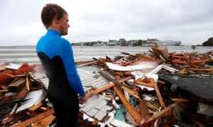 Currie Wagner looks over the debris from his grandmother Betty Wagner's house, destroyed by Sandy, which ended up atop the Mantoloking Bridge in New Jersey.