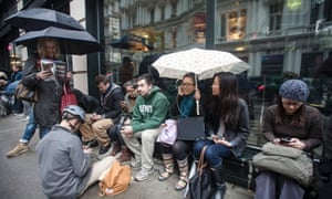 New Yorkers from mid and downtown who are without electricity in their homes, gather to charge their phones and laptops from the sidewalk electrical outlets and power sources belonging to local hotels.