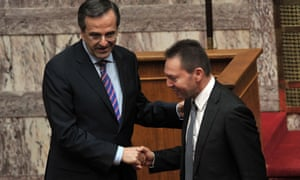 Greece's Finance Minister Yiannis Stournaras (R) shakes hands with Greece's Prime minister Antonis Samaras during a presentation of  a draft budget to parliament outlining new austerity measures needed to unlock fresh rescue loans  on October 31, 2012 in Athens.