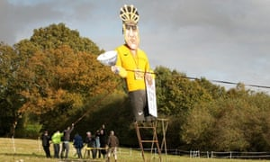 Lance Armstrong is about to be burnt at the stake by members of Edenbridge Bonfire Society as they erect him as this year's celebrity guy in Kent.