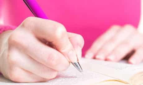 Young woman with pen