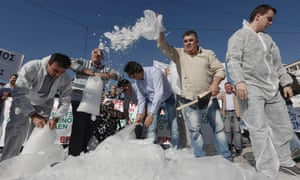 Residents from towns in northwestern Greece throw ice cubes during a protest against the hiking of taxes on heating fuel in Athens October 31, 2012.