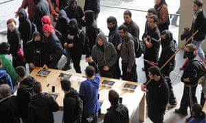Members of the CGT and CNT worker's unions enter inside an Apple store during a demonstration against the government's cuts in Barcelona on October 31, 2012.