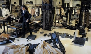 A worker of a Zara store stands among untidy merchandise after protesters dislodged clothing shelves of the store during a demonstration organized by the CGT and CNT worker's unions against the government's cuts on October 31, 2012 in Barcelona.