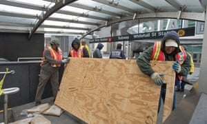 Employees from the MTA work to restore the South Ferry subway station after it was flooded by seawater in the aftermath of Hurricane Sandy.