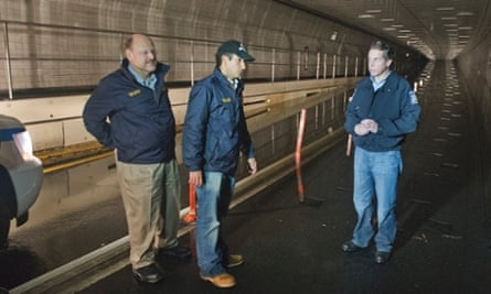 Governor Andrew Cuomo, right, tours the damaged Brooklyn-Battery tunnel with MTA chairman Joseph Lhota (far left) and Jim Ferrara, president of MTA bridges and tunnels.