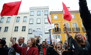 Demonstrators take part in a protest against the Portuguese government's 2013 austerity budget, near the Parliament in Lisbon on October 31, 2012.