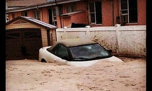 A sunken car on Rockaway Peninsula, Queens, in a photograph tweeted by Gov. Andrew Cuomo.
