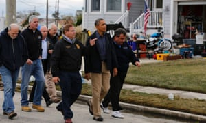 U.S. President Barack Obama (2nd R) walks with New Jersey Governor Chris Christie (R) and other officials in a neighborhood while touring damage done by Hurricane Sandy in Brigantine, New Jersey, October 31, 2012. Putting aside partisan differences, Obama and Christie toured storm-stricken parts of New Jersey together on Wednesday, taking in scenes of flooded roads and burning homes in the aftermath of superstorm Sandy. REUTERS/Larry Downing  (UNITED STATES - Tags: POLITICS DISASTER) :rel:d:bm:GF2E8AV1NBX01