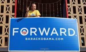 Obama supporter Braden Silverman looks down from his balcony near the campus prior to the presidential debate at the University of Denver.