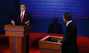 President Barack Obama watches as Republican presidential nominee Mitt Romney answers a question during the first presidential debate