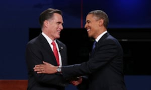 Barack Obama shakes hands with Mitt Romney at the end of the presidential debate in Denver.