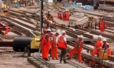 Workers replacing railway track
