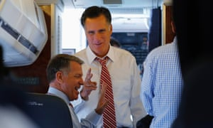 Republican presidential nominee Mitt Romney talks to senior advisor Bob White on his campaign plane at the airport in Denver, Colorado.