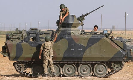 Turkish soldiers stand guard on border with Syria