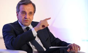 Greece's Prime Minister Antonis Samaras answers questions after his keynote address as part of the International Herald Tribune Global Conversation in Paris on October 4, 2012.