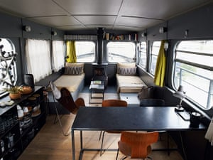 Homes: Paris Boat: Dining room and living room area on houseboat