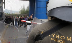 Workers of the Skaramangas shipyard break the entrance of the Defence Ministry in Athens, Greece, 04 October 2012.