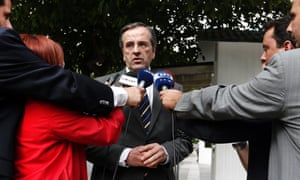 Greek Prime Minister Antonis Samaras talks to reporters outside his office in Athens shortly after arriving in Greece October 5, 2012.