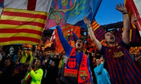 Barcelona fans wave a Catalan flag