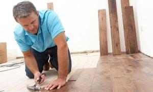 Man laying wooden flooring