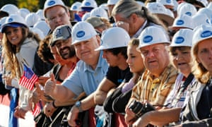 Hard hats at the ready for the arrival of Republican presidential candidate, Mitt Romney.