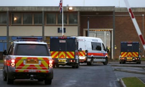 A police motorcade arrives at prison to collect Abu Hamza and other terror suspects for extradition