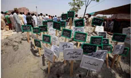Temporary headstones of victims at an Ahmadi Muslim graveyard in Chenab Nagar, Pakistan