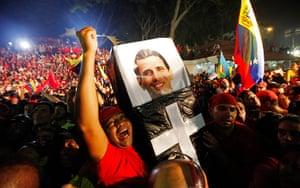 Venezuela elections: Supporters hold a mock coffin with a portrait Henrique Capriles