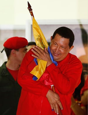 Venezuela elections: Venezuelan President Hugo Chavez hugs the national flag