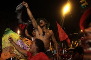 Venezuela elections: Supporters of  President Hugo Chavez celebrate at the Miraflores palace