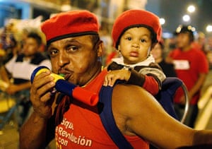 Venezuela elections: Supporters of President Hugo Chavez cheer as he appears on a balcony