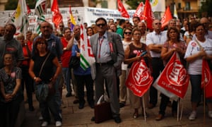 Demonstrators holding flags of the General Workers Union (UGT) and of the Comisiones Obreras (CCOO) attend a protest against further tax hikes and austerity cuts in Malaga, southern Spain October 7, 2012.