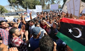 Libyan protesters from the city of Bani Walid rally outside congress in Tripoli on Sunday against the government's decision besiege their city in their effort to arrest the killers of a man credited with capturing Muammar Gaddafi.