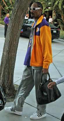Rapper Snoop Dogg wears Adidas Superstars trainers