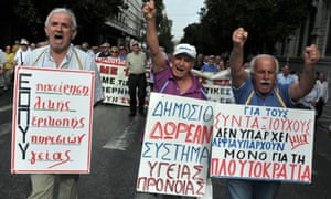 Greek pensioners shout slogans while marching in central Athens to protest the new austerity cuts on October 8, 2012.