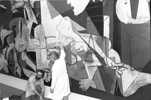 Defaced art: New York City's Museum of Modern Art employees clean paint off Guernica