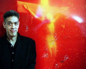 Defaced art: Andres Serrano stands in front of Piss Christ