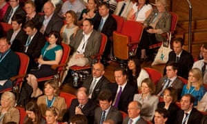 Conference delegates including the prime minister listen to George Osborne