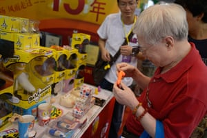China Sex expo: An elderly gentleman inspects sex toys