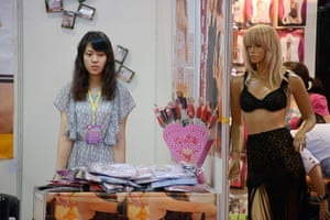 China Sex expo: A young woman on a stand