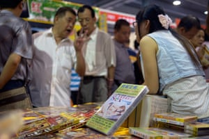 China Sex expo: A man haggles about the price of some 'instructional' sex DVDs on sale