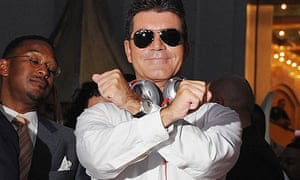 Simon Cowell making the X Factor sign