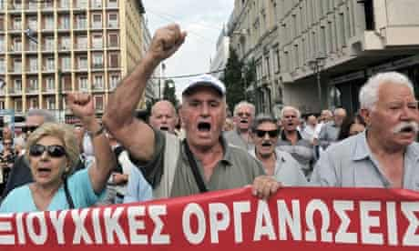 Greek pensioners shout slogans while marching in central Athens to protest the new austerity cuts