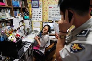 FTA: Kim Hong-Ji: A police officer, right, talks on a phone