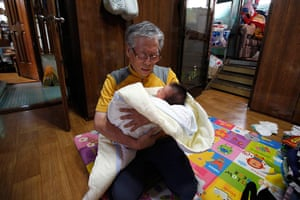 FTA: Kim Hong-Ji: South Korean pastor Lee Jong-rak holds an abandoned baby boy