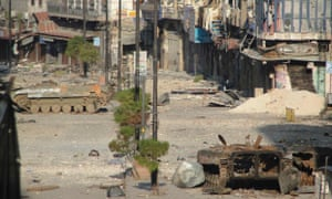 Damaged Syrian Army tanks, belonging to forces loyal to Syria's President Bashar al-Assad, are seen after clashes with the Free Syrian Army in the old city of Homs October on Friday.