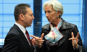 Greece's Finance Minister Yannis Stournaras (L) talks with Director of the International Monetary Fund (IMF) Christine Lagarde (R) at a eurozone finance ministers meeting in Luxembourg October 8, 2012.