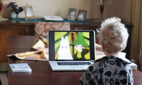 Baby watching television on a laptop